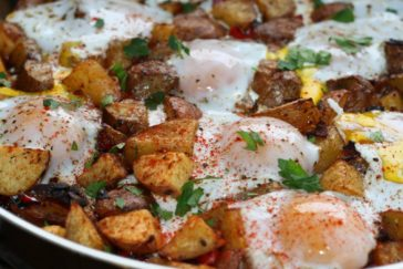 Potato, Caramelized Onion, & Roasted Red Pepper Hash with Baked eggs & UP Olive Oil
